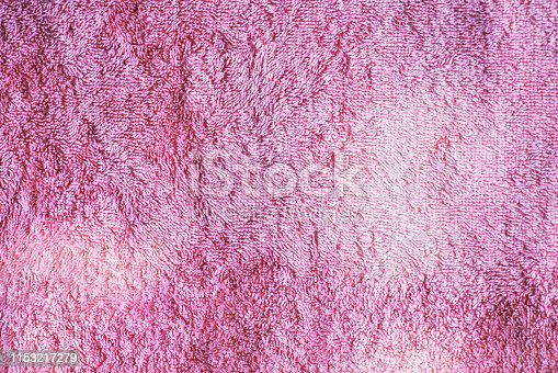 1151113068 istock photo Texture of soft tissue fibers. Close-up.Fluffy Gentle baby fabric with waves and folds. Soft pastel textile texture. Folds on the soft fabric. Rose towel terry cloth. 1153217279