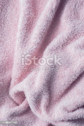 1151113068 istock photo Texture of soft tissue fibers. Close-up.Fluffy Gentle baby fabric with waves and folds. Soft pastel textile texture. Folds on the soft fabric. Rose towel terry cloth. 1196511162