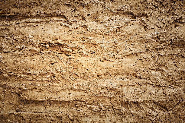 texture of soil wall of traditional house - mud stock photos and pictures