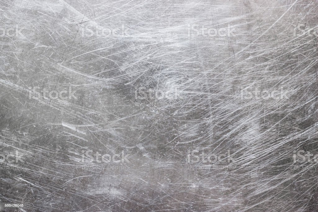Texture of stainless steel wallpaper, background of metal with scuffs - Stock image .