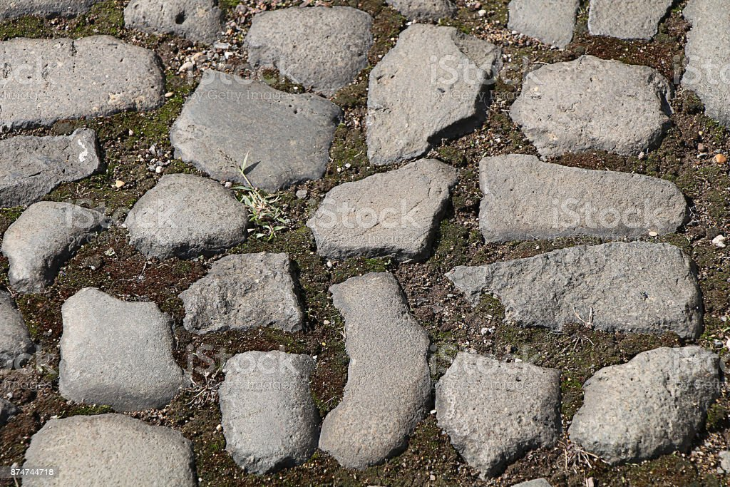 Texture of stones and cobblestones. Street lined with a paved stone in the center of the city stock photo