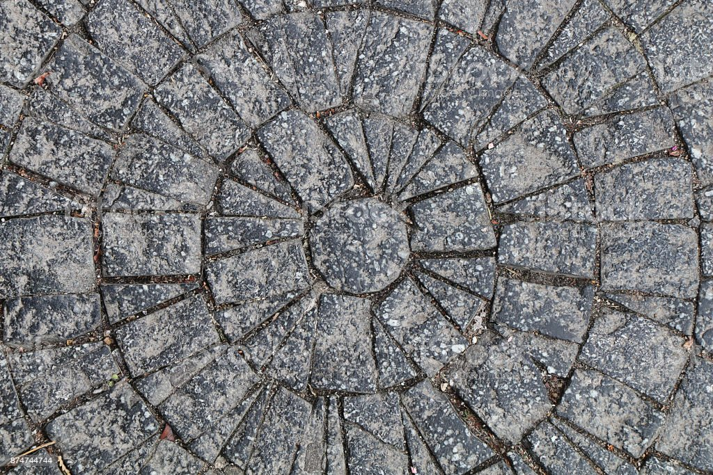 Texture of stones and cobblestones. Street lined with a paved stone in the shape of a circle stock photo