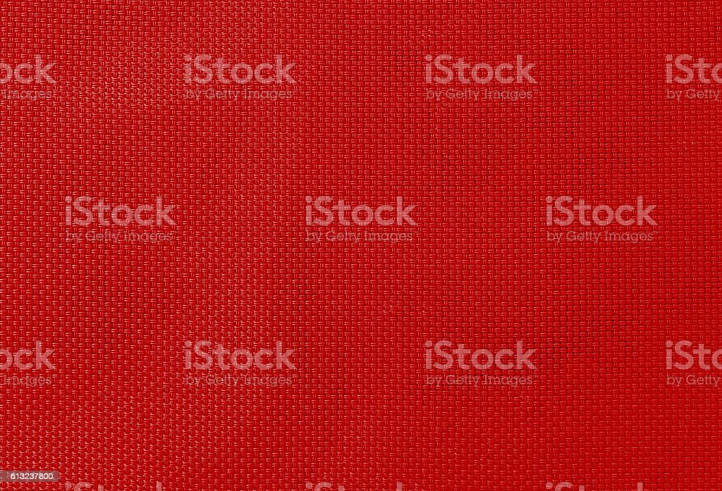 texture of synthetic fabric red color stock photo