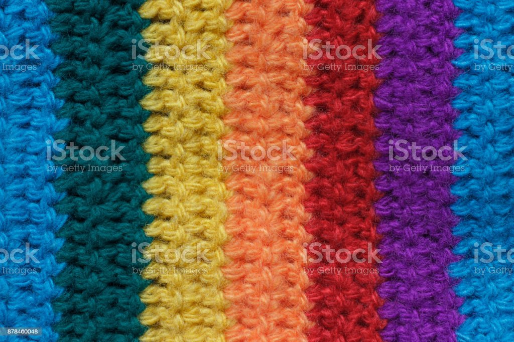 Texture of the cloth is knitted from multi-colored yarn. stock photo