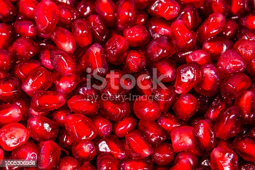 istock Texture of the garnet seeds for the background 1005306956