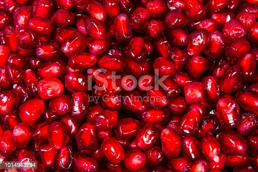 istock Texture of the garnet seeds for the background 1014943294
