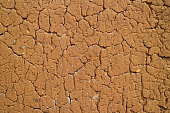 Texture of the Orange Brown Color Rustic Soil Wall in Northern Peru for Background, Texture or Pattern