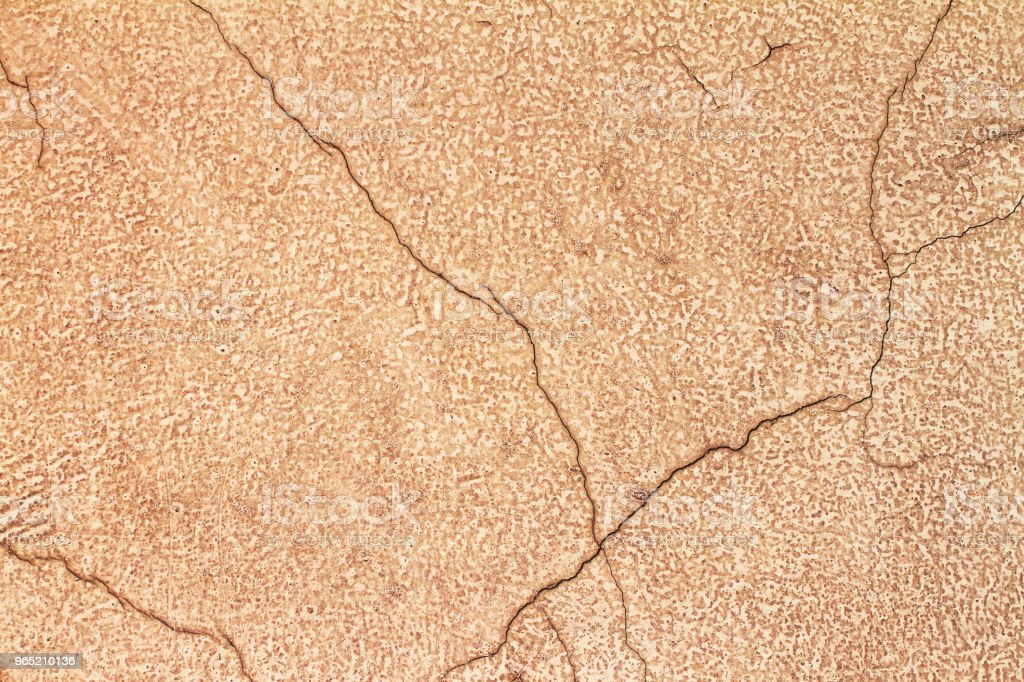 Texture of the yellow cracked plaster royalty-free stock photo