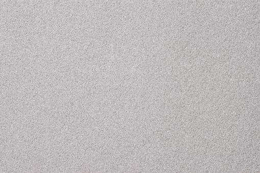 Texture of thermal insulating styrofoam closeup. Structure polystyrene plastic. Light gray color. For background, design with copy space text or image