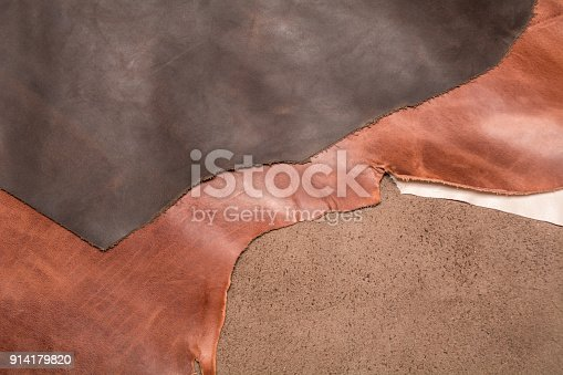 istock Texture of three pieces of natural brown leather. Leather background. 914179820