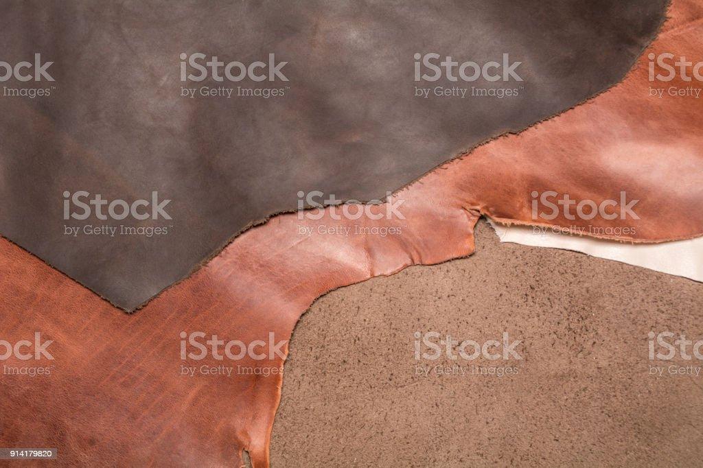 Textura de três peças de couro marrom natural. Fundo de couro. - foto de acervo