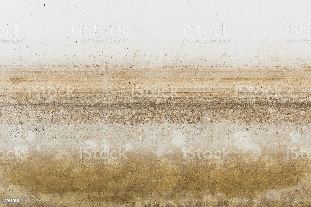 Texture of water level stain pattern after flood stock photo