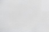 Texture of white canvas with material flake small pieces, abstract pattern background