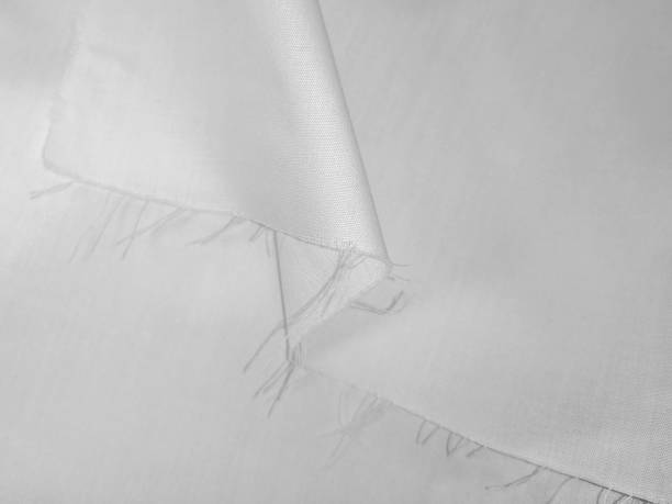 Texture of white fabric with a fringe on a cut edge stock photo