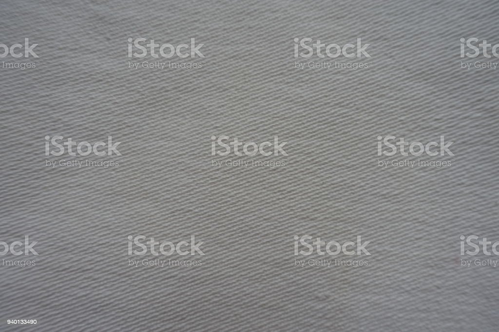 Texture of white jeans fabric from above stock photo