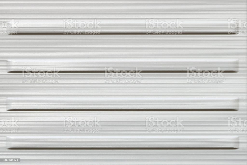 Texture of white metal or hard plastic, abstract background stock photo
