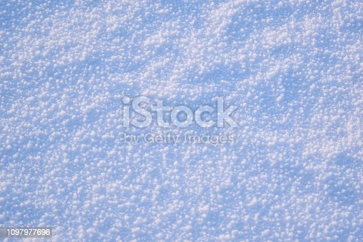 166319867 istock photo Texture of white snow with blue tint winter background. 1097977696
