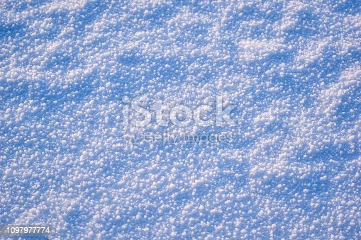 166319867 istock photo texture of white winter snow with blue tint. large large snowflakes. winter background 1097977774