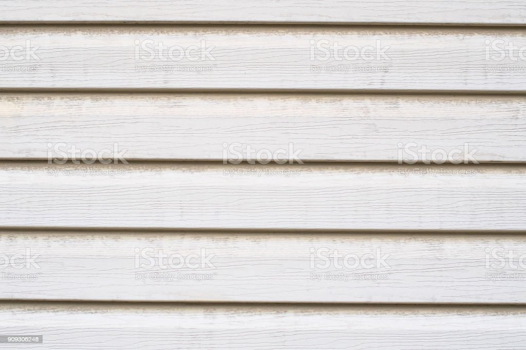 Texture of white wooden siding. Old wooden panels covered with d stock photo