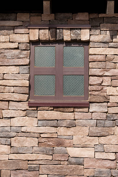 Texture of Window in a stone brick wall stock photo
