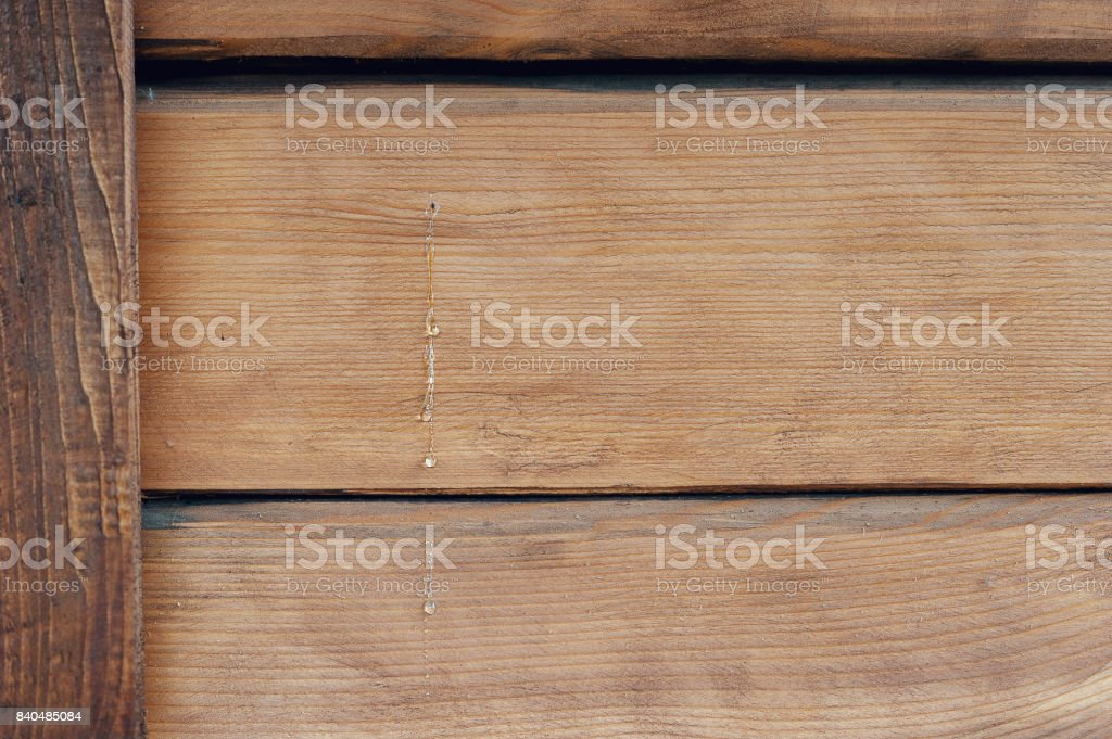 Texture of wood with flowable resin on the wall of a house made of wood stock photo