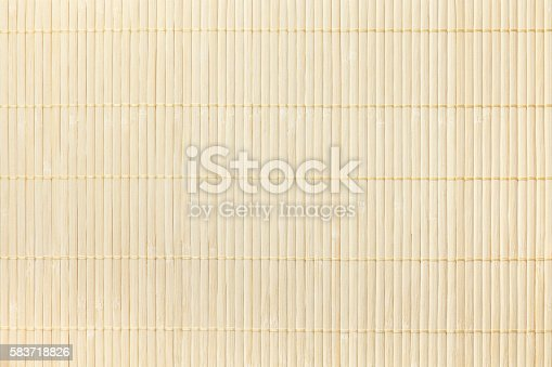 Texture of wooden light background of the tablecloth. Bamboo traditional napkin for a table.
