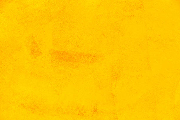 Texture of yellow plaster cement wall stock photo