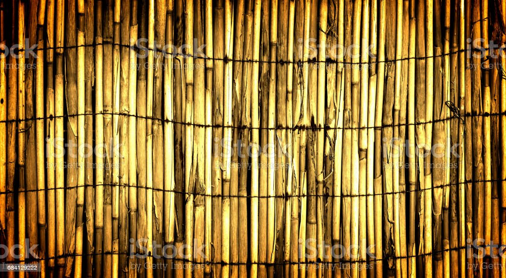 Texture of yellow wall of bound bamboo high contrasted with vignetting effect royalty-free stock photo