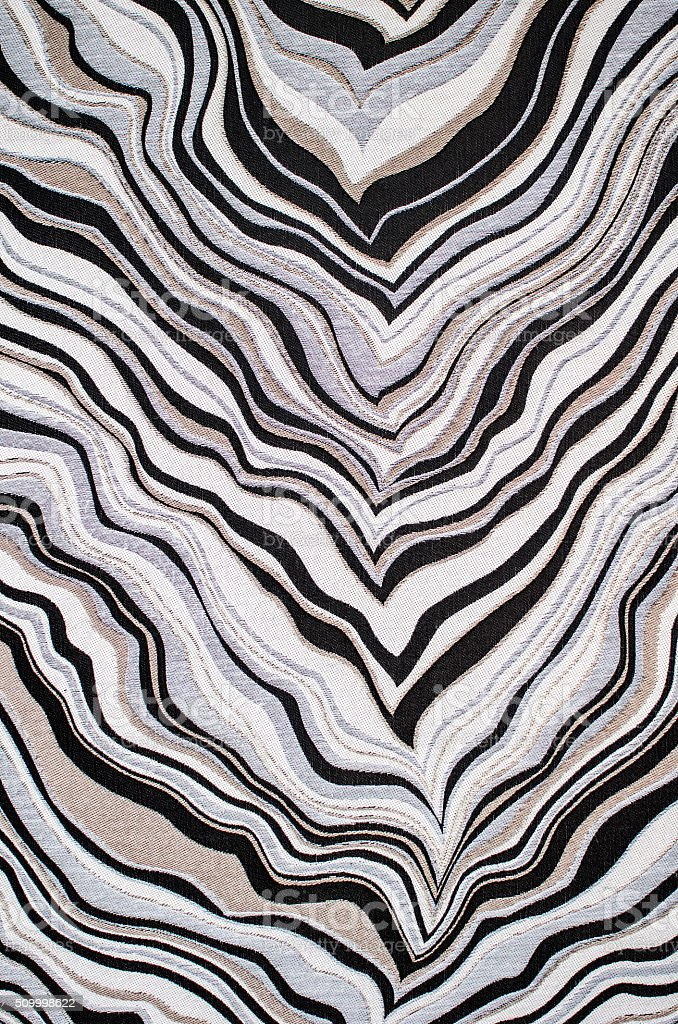 Texture of zebra chevron fabric in black, white, and silver stock photo
