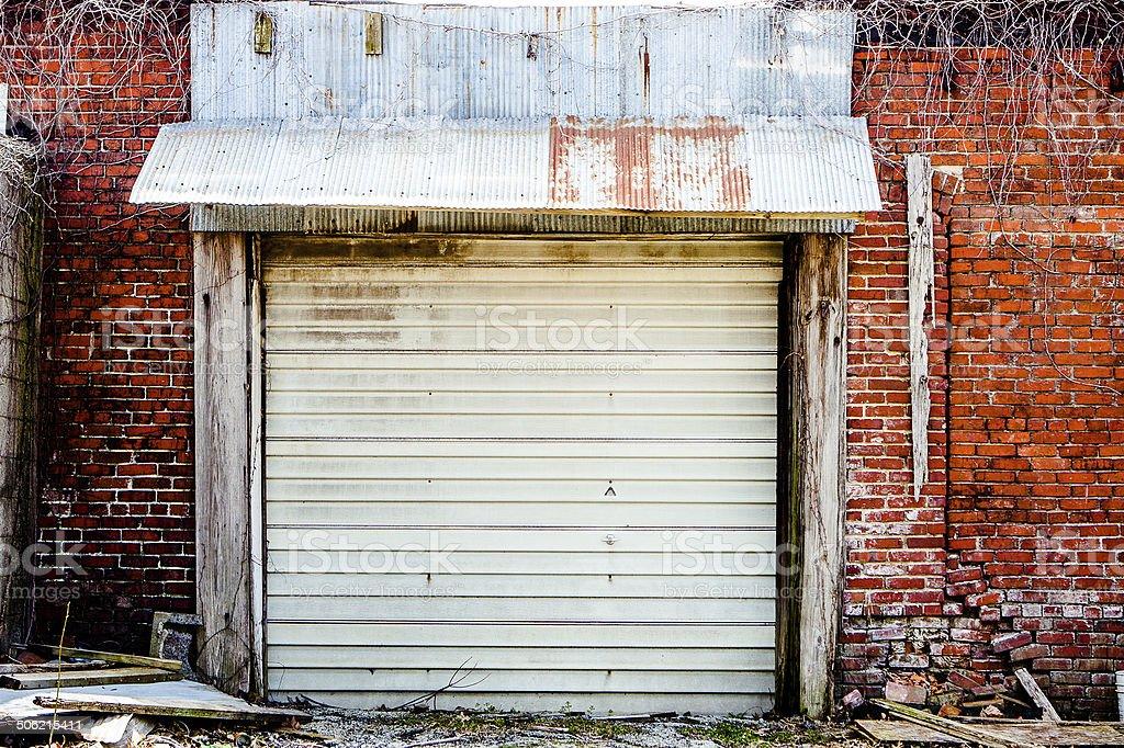 Texture - Old Garage Door, Brick Wall, Vines stock photo
