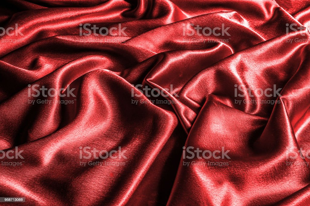 texture, pattern. silk fabric red, metallic thread. metallic sheen. Introducing a dazzling metallic abstract jacquard. A luxurious and textured, metallic thread provides an unrivaled shiny brilliance. stock photo