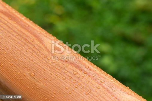 Raindrops on a varnished wooden surface.