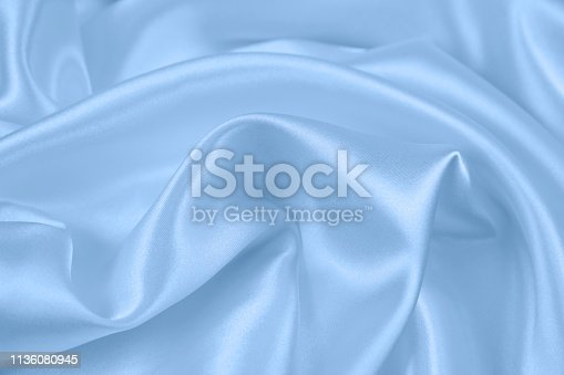 859441184istockphoto Texture satin fabric blue color for the background 1136080945
