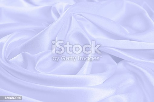 859441184istockphoto Texture satin fabric blue color for the background 1136080949