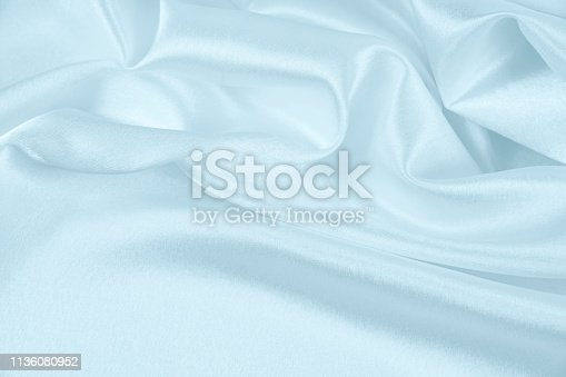 859441184istockphoto Texture satin fabric blue color for the background 1136080952