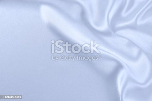 859441184istockphoto Texture satin fabric blue color for the background 1136080954