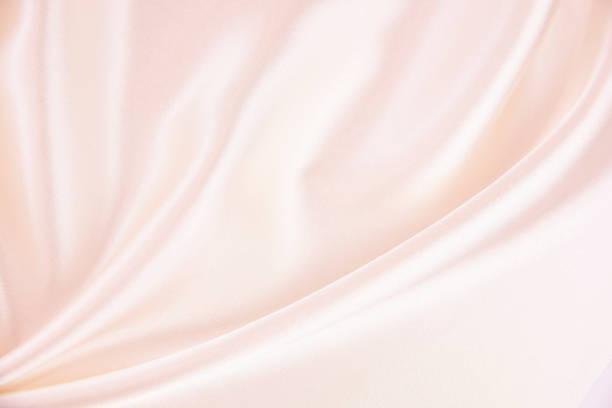 textuur satijnen stof roze kleur voor de achtergrond - satijn stockfoto's en -beelden