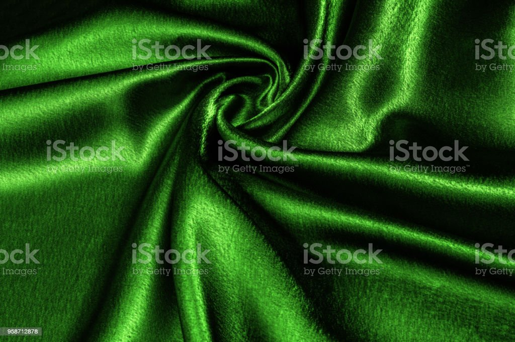 texture silk fabric is green metallic thread. metallic sheen. This metal gold and green abstract jacquard reminds us of the underwater paradise. Splashes of abstract design come out of the metal star stock photo