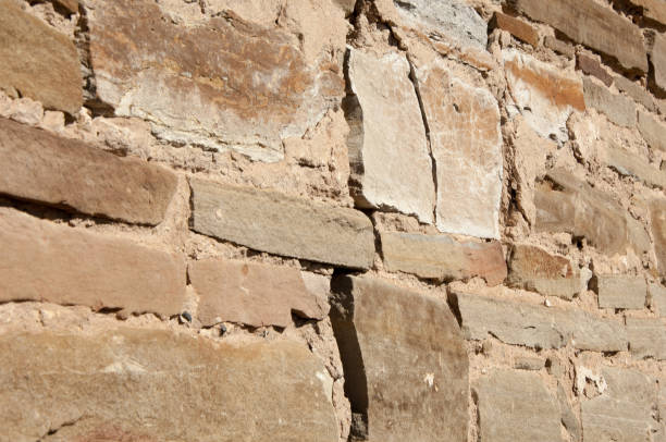 Texture. Wall lined with stone wild stock photo