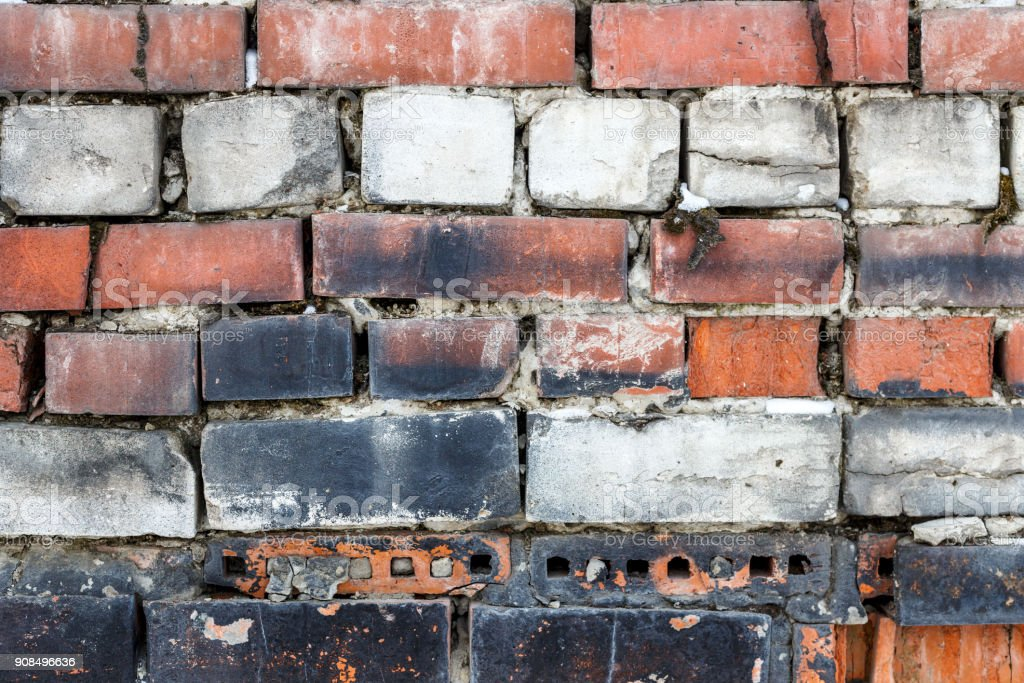 Textured background. Multi-colored brick wall stock photo
