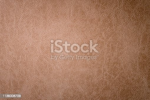 Textured background surface of leather upholstery furniture close-up. burlap brown color fabric structure.