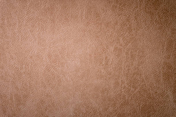 Textured background surface of leather upholstery furniture close-up. burlap brown color fabric structure stock photo