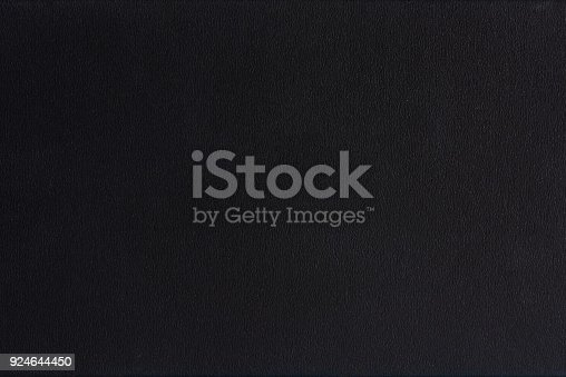 istock Textured blank black paper background 924644450