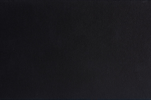 Textured blank black paper background. Black paper surface