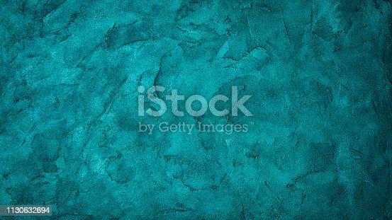 istock Textured bright turquoise concrete background 1130632694