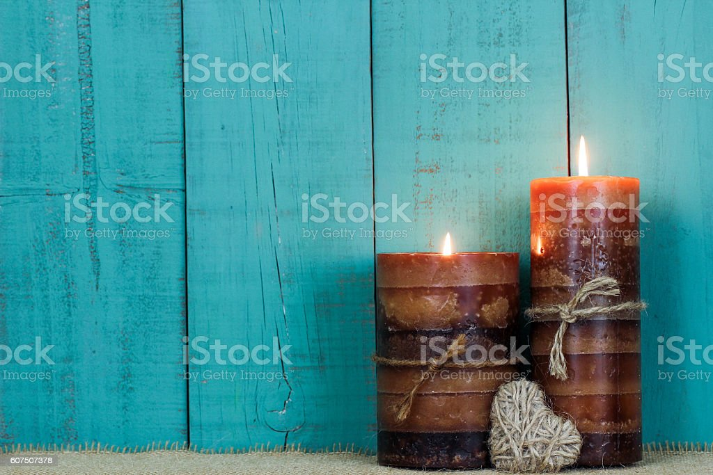 Textured candles and rope heart stock photo