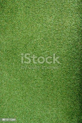 istock Textured fine artificial grass background 961511344