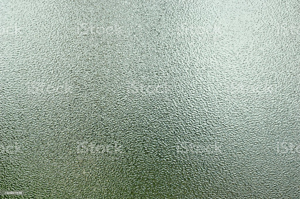 Textured, frosted glass window pane stock photo