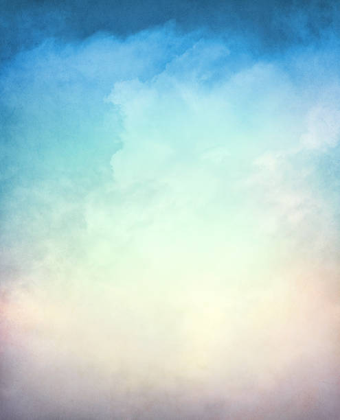 Textured Gradient Cloudscape An abstraction of clouds and fog on a textured background with a multi-colored gradient.  Image displays a distinct paper grain and texture at 100 percent. smoke physical structure stock pictures, royalty-free photos & images