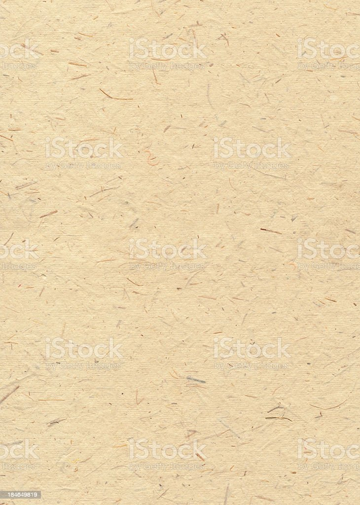 Textured hand made paper with fibres visible stock photo
